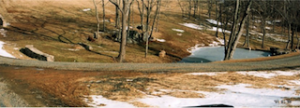Entrance Road and Water Feature by Monomoy, Inc.